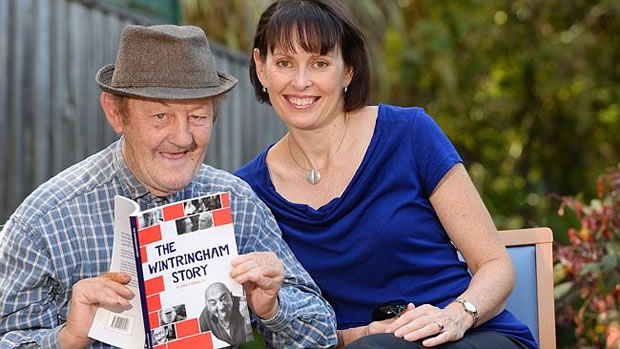 Elaine Farrelly with Wintringham, Flemington resident, Geoffrey Wolter and a copy of her new Book - Herald Sun